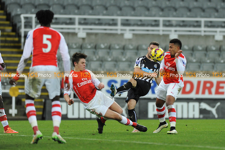 Adam Armstrong of Newcastle United has a shot blocked by Arsenal defenders  - Newcastle United Under-21 vs Arsenal Under-21 - Barclays Under-21 Premier League Football at St James Park, Newcastle United FC - 09/02/15 - MANDATORY CREDIT: Steven White/TGSPHOTO - Self billing applies where appropriate - contact@tgsphoto.co.uk - NO UNPAID USE