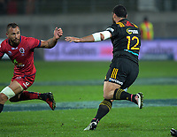 Charlie Ngatai steps inside Quade Cooper during the Super Rugby match between the Chiefs and Reds at Yarrow Stadium in New Plymouth, New Zealand on Saturday, 6 May 2017. Photo: Dave Lintott / lintottphoto.co.nz