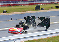 May 15, 2016; Commerce, GA, USA; NHRA funny car driver John Hale slows with the help of his parachutes after exploding the carbon fiber body off his car during the Southern Nationals at Atlanta Dragway. Hale was uninjured. Mandatory Credit: Mark J. Rebilas-USA TODAY Sports