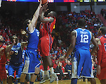 Ole Miss guard Chris Warren (12)  shoots as Kentucky's Josh Harrellson (55)  defends at the C.M. &quot;Tad&quot; Smith Coliseum in Oxford, Miss. on Tuesday, February 1, 2011. Ole Miss won 71-69.