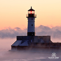 """Steamy Sunrise"" ~ Canal Park's lighthouse stands among Lake Superior's sea smoke during a subzero sunrise in Duluth."