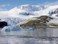 """Mountains, a glacier, and icebergs near the old British research base named """"Danco Hut, Base O"""" on Danco Island in the Errera Channel near Paradise Harbor (aka Paradise Bay), Antarctica. The base was built 1955-1956. DCF"""