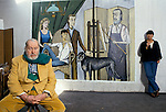 Bernard Buffet French artist expressionist painter (1928-1999) France Circa 1995. His studio at home Tourtour Provence France with wife Annabel Schwob. The painting is of his family with Annabel seated.