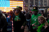 Revelers walk in Times Square as they take part in the 252nd annual St. Patrick's Day Parade in New York City. Photo by Eduardo Munoz Alvarez / VIEWpress.