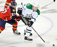 Dallas Stars' Radek Faksa, right, and Florida Panthers' Vincent Trocheck chase the puck during the second period of an NHL preseason hockey game, Friday, Sept. 20, 2013, in San Antonio, Texas. (Darren Abate/DA Media)