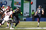 Seattle Seahawks punter Jon Ryan (9) punts against the Denver Broncos at CenturyLink Field in Seattle, Washington on September 21, 2014. The Seahawks won 26-20 in overtime.    ©2014. Jim Bryant Photo. All rights Reserved.