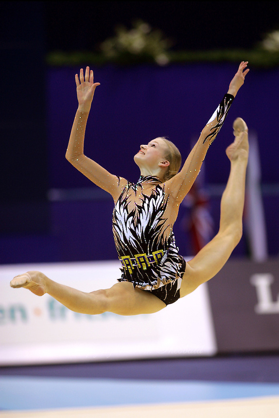 Olga Kapranova of Russia wins gold in clubs event final (here split leaps during toss and recatch) in rhythmic gymnastics at World Championships in Baku, Azerbaijan, October 6, 2005.  World Championships run to October 10.  (Photo by Tom Theobald)