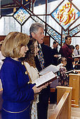 United States President Bill Clinton, right, first lady Hillary Rodham Clinton, left, and Chelsea Clinton, center, attend Easter services at Camp David, the presidential retreat near Thurmont, Maryland on April 16, 1995.<br /> Mandatory Credit: Ralph Alswang / White House via CNP