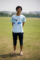 Hongjie, a student, age 21, poses for a portrait in Nanjing. Response to 'What does China mean to you?': 'To me, China is a country, but even more a home. The Chinese characters [in the word &quot;China&quot;] represent the meaning &quot;moderate,&quot; which illustrates that Chinese people don't get involved. From peace to people.'  Response to 'What is China's role in the future?': 'China has always been a large country. There has just been even more development after the recent economic changes.'