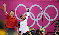 London, England - Thursday, August 2, 2012: USA's Gabrielle Douglas celebrates with her coach Liang Chow after winning gold in the women's gymnastics individual all around at the London 2012 Summer, Olympic Games, North Greenwich Arena, London. .