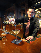Matt Tesch pours a shaken martini for a customer at Andrew's, the bar at the Delafield Hotel on Friday, April 8, 2011. The photo was taken with available light, 1/5 of a second at ISO 5000. It ran full page in the entertainment section of the Milwaukee Journal Sentinel to go with a story about hotel bars.
