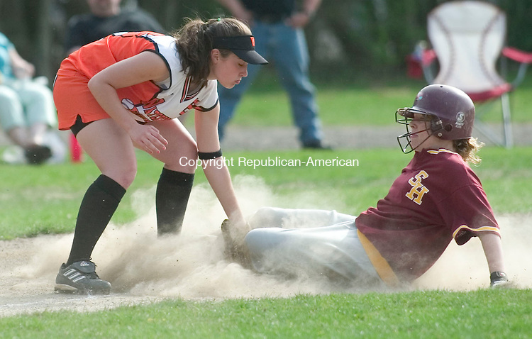 WATERBURY, CT- 25 APRIL 2008- 042508JT06-<br /> Sacred Heart's Megan Sheehy slides safely into third as Watertown's Erica Brieve tries to defend the base during Friday's game at Municipal Stadium.<br /> Josalee Thrift / Republican-American