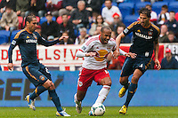 Thierry Henry (14) of the New York Red Bulls is marked by Marcelo Sarvas (8) and Omar Gonzalez (4) of the Los Angeles Galaxy. The New York Red Bulls defeated the Los Angeles Galaxy 1-0 during a Major League Soccer (MLS) match at Red Bull Arena in Harrison, NJ, on May 19, 2013.