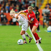 Betsy Hassett (l) of team New Zealand and Faye White of team England during the FIFA Women's World Cup at the FIFA Stadium in Dresden, Germany on July 1st, 2011.