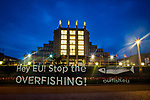Light painting projection by marine conservation campaign group Our Fish reading &ldquo;Hey EU! Stop the Overfishing&rdquo; outside the Brussels Seafood Expo, which opens on April 25.  Despite the reformed Common Fisheries Policy coming into force in January 2014, many EU countries are falling behind in their obligations to enforce the new rules, leading to continuation of unsustainable fishing in Europe&rsquo;s waters. According to a recent EU Scientific, Technical and Economic Committee for Fisheries (STECF) report, six out of ten North Atlantic fisheries are unsustainable, while the Mediterranean is 96% overfished. <br /> <br /> Photo Copyright Our Fish/Dave Walsh. Permission granted for publication regarding 2017 Global Seafood Expo. Credit line must be included. <br /> <br /> <br /> Our Fish works to ensure European member states implement the Common Fisheries Policy and achieve sustainable fish stocks in European waters.<br /> <br /> Our Fish brings together organisations from across Europe to speak with a common voice: overfishing of our waters must be stopped, and solutions put in place that ensure Europe&rsquo;s waters are fished sustainably. Our Fish demands that the Common Fisheries Policy be properly enforced, and Europe&rsquo;s fisheries effectively governed.<br /> <br /> Our Fish calls on all EU Member States to set annual fishing limits at sustainable limits based on scientific advice, and to ensure that their fishing fleets prove that they are fishing sustainably, through monitoring and full documentation of their catch.<br /> http://www.ourfish.eu