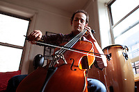 Musician Mike Block in his apartment in Manhattan, New York on May 01, 2011. The Julliard-trained cellist and composer is bringing a new performance series GALA/NYC to the Brooklyn Lyceum in Park Slope..CREDIT: Melanie Burford/Prime for The Wall Street Journal..Slug: NYMIKEBLOCK