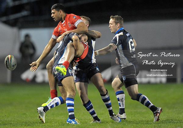 Daniel Tupou (Tonga) is tackled by David Scott (Scotland)   - PHOTO: Mandatory by-line: Garry Bowden/SIPPA/Pinnacle - Photo Agency UK Tel: +44(0)1363 881025 - Mobile:0797 1270 681 - VAT Reg No: 768 6958 48 - 29/10/2013 - Rugby League World Cup 2013, Tonga v Scotland, Derwent Park, Workington, Cumbria, England