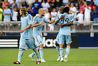 Julio Cesar Sporting KC celebrates his game winning goal with Omar Bravo (99) and Aurelien Collin... Sporting KC defeated Vancouver Whitecaps 2-1 at LIVESTRONG Sporting Park, Kansas City, Kansas.