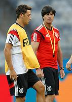 Mesut Ozil with Germany manager Joachim Low