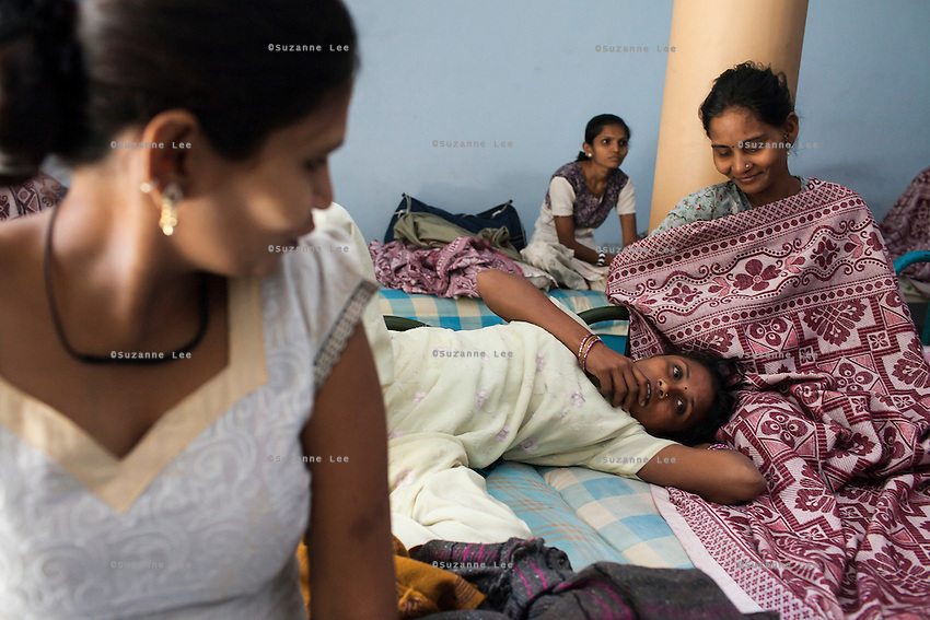 Surrogates laze around and chat in the surrogate's hostel in the compound of the Akanksha Infertility Center in Anand, Gujarat, India on 12th December 2012.  Photo by Suzanne Lee / Marie-Claire France