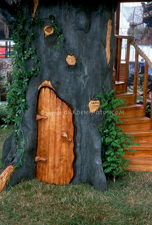 Treehouse for children, premade, with door at base and steps, a playhouse for kids