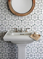 Medina, a handmade mosaic shown in polished Ming Green and Carrara and honed Thassos, is part of the Miraflores Collection by Paul Schatz for New Ravenna.<br />