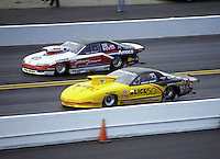 Nov. 6, 1997; Pomona, CA, USA; NHRA pro stock driver Bruce Allen (near) races alongside Allen Johnson during the World Finals at the Pomona Raceway. Mandatory Credit: Mark J. Rebilas-