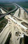 Nederland, Gelderland, Echteld, 01-04-2002; aanleg nieuwe spoorviaduct spoorlijn Tiel-Elst, over de te verleggen A15 en de nog te bouwen Betuweroute (richting Tiel, naar het Westen); zand, beton, Betuwelijn, lokale verbindingsweg, verkeer en vervoerbouw, transport, infrastructuur, infrabundel, mobiliteit, planologie; zie ook andere (lucht)foto's van deze lokatie, deel van de serie Panorama Nederland <br /> luchtfoto (toeslag); aerial photo (additional fee required); .foto Siebe Swart / photo Siebe Swart