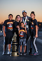 Nov 13, 2016; Pomona, CA, USA; NHRA top fuel driver Antron Brown poses for a family portrait with the world championship trophy following the Auto Club Finals at Auto Club Raceway at Pomona. Mandatory Credit: Mark J. Rebilas-USA TODAY Sports
