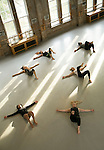 Students stretch out during an advanced modern master dance class taught by Sam Wentz of the Trisha Brown Dance Company in The Ark on Duke's East Campus. Duke Performances has created residencies in which the artists it brings to campus interact with students.