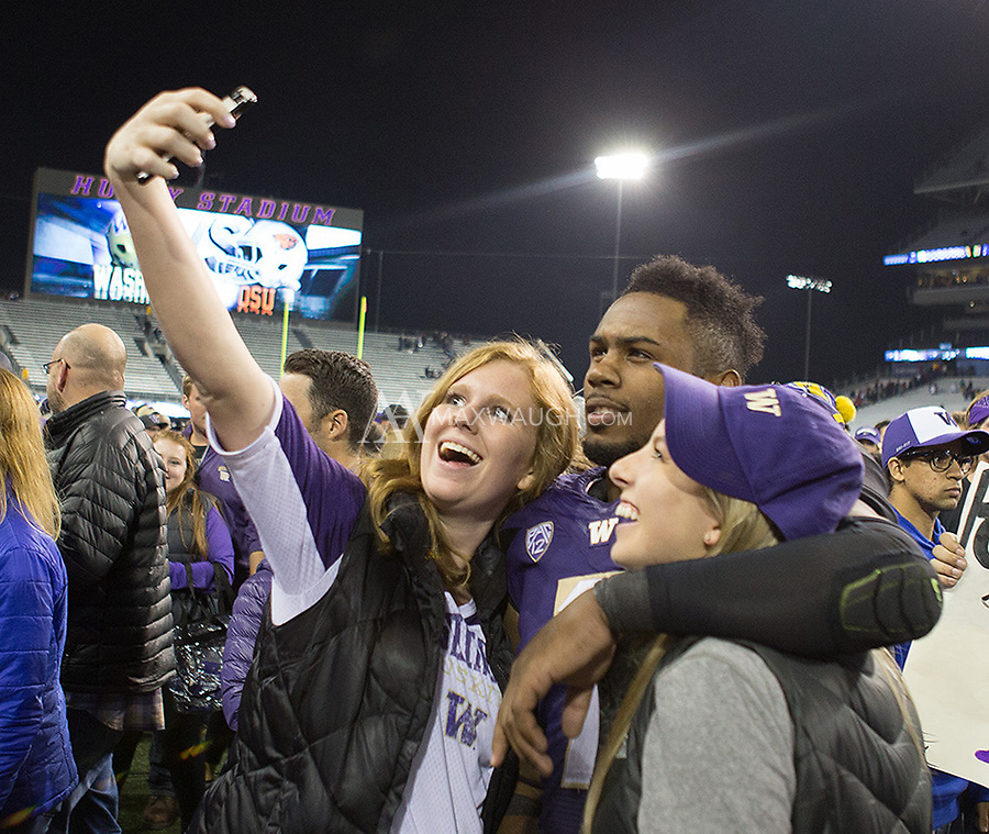 Keishawn Bierria poses for a photo with happy Husky fans.