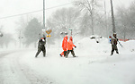 Ice fisherman walking back to their vehicles after a morning of fishing in Madison, Wisconsin. ..