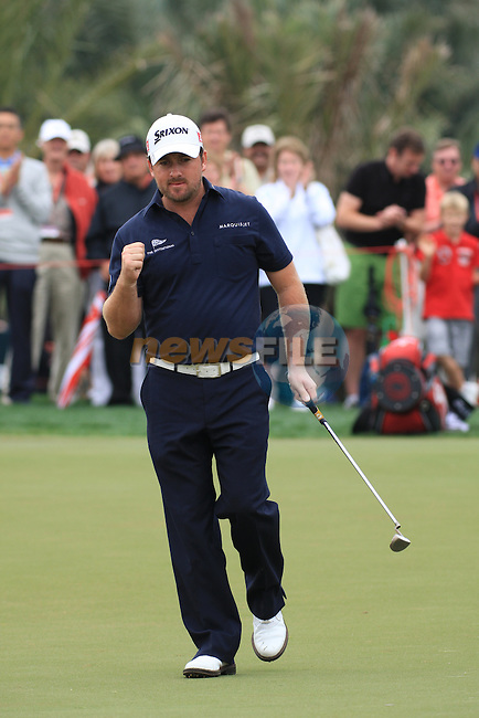 Graeme McDowell thumps the air after sinking his putt on the 8th green on day two of the Abu Dhabi HSBC Golf Championship 2011, at the Abu Dhabi golf club, UAE. 21/1/11..Picture Fran Caffrey/www.golffile.ie.
