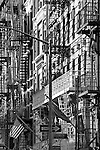 New York City street scene with fire escapes and flag