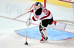 9 January 2010: New Jersey Devils' goaltender Martin Brodeur clears the puck during the second period against the Montreal Canadiens at the Bell Centre in Montreal, Quebec, Canada. The Devils edged out the Canadiens 2-1 in overtime. Mandatory Credit: Ed Wolfstein Photo