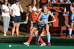 23 September 2016: North Carolina's Emma Bozek (right) and Syracuse's Laura Hurff (left). The University of North Carolina Tar Heels hosted the Syracuse University Orange at Francis E. Henry Stadium in Chapel Hill, North Carolina in a 2016 NCAA Division I Field Hockey match. UNC won the game 3-2 in two overtimes.