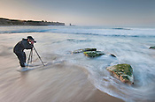 Workshop participant photographing surf, Four Mile Beach, Monterey Bay, California