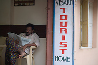 January 26th 2008 _Trivandrum, India _A man reads the morning paper, which sitting in the Visakh Tourist Home in the Kerala state capital city of Trivandrum. Photograph by Daniel J. Groshong/Tayo Photo Group