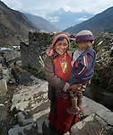 Chiring Sangmo Tamang holds her son Dev Rai, 5, in the village of Gatlang, in the Rasuwa District of Nepal near the country's border with Tibet.
