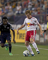 New York Red Bulls midfielder Dax McCarty (11) passes the ball as New England Revolution forward Kenny Mansally (7) closes. In a Major League Soccer (MLS) match, the New England Revolution tied New York Red Bulls, 2-2, at Gillette Stadium on August 20, 2011.