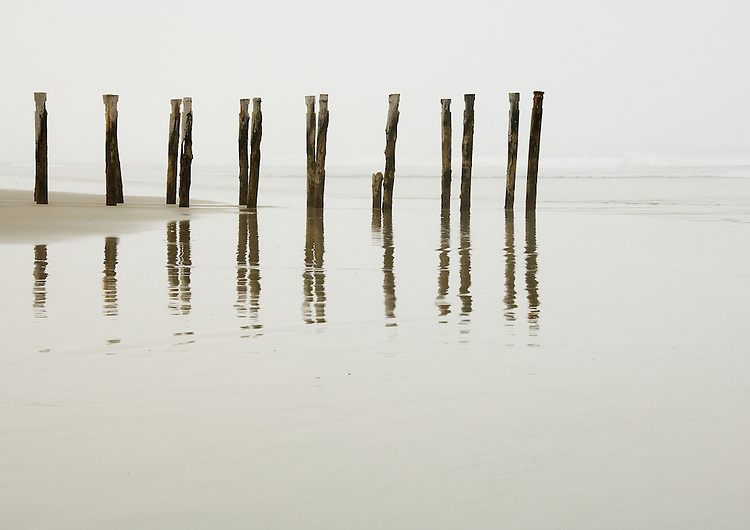 Old wharf at St Clair beach reflected in the water at low tide on a foggy morning, Dunedin, New Zealand - stock photo, canvas, fine art print
