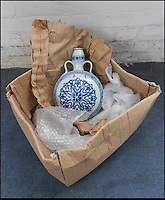 BNPS.co.uk (01202 558833).Pic: Dukes/BNPS..Over the moon...flask...The broken vase arrived at the auction house in a tatty old cardboard box...A broken Chinese vase that was delivered by its elderly owner to an auction house in a battered cardboard box has sold for £120,000...The man, aged in his 80s, had inherited the 11 inch moonflask vase from a relative many years ago and had no idea of its worth...The top part had once broken off and had been very crudely stitched back together using large metal staples, a technique last used by ceramic specialists in the 1960s...Although experts suspected the piece dated back to Imperiel China, the ugly 11ins-long scar led to them to put a 2,000 pounds pre-sale estimate on it...But scores of Chinese collectors lined up to bid on the blue and white vase when it came up for auction, reaffirming the belief the piece dated back to the 15th century...It was finally bought for 119,500 pounds. Had it not had the hefty crack running through it, it is likely the Ming vase would have fetched one million pounds..