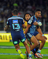 Lolagi Visinia pops the ball to Charles Piutau in the tackle of Ma'a Nonu during the Super Rugby match between the Hurricanes and Blues at FMG Stadium, Palmerston North, New Zealand on Friday, 13 March 2015. Photo: Dave Lintott / lintottphoto.co.nz