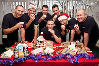 Celebrating with goodies from Greggs are firefighters from Stockhill Fire Station, Nottingham. Pictured from left: Steve Dunnett, Richard Lord, Martin Aldred, Tim Roe (seated) Ben Smith, Nick Cousins and Robin Watts.