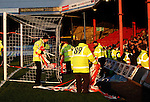 Grimsby Town 1 Lincoln City 3, 28/12/2014. Blundell Park, Football Conference. Stewards removing red and white tape thrown by Lincoln fans before kick off.  Photo by Paul Thompson.