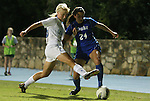 13 October 2011: North Carolina's Caitlin Ball (26) defends against Duke's Mollie Pathman (24). The University of North Carolina Tar Heels defeated the Duke University Blue Devils 1-0 at Fetzer Field in Chapel Hill, North Carolina in an NCAA Division I Women's Soccer game.