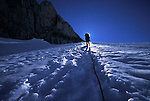 A climber hikes up a glacier in the coast range of British Columbia, Canada.