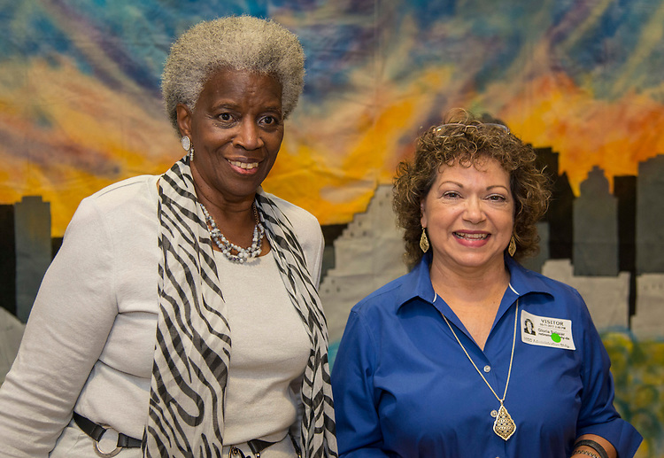 Modesta Lily, left and Gloria Salazar, right, during a Retiree Reception at Hattie Mae White, May 11, 2017.