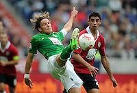 FUSSBALL   1. BUNDESLIGA   SAISON 2012/2013   3. SPIELTAG Hannover 96 - SV Werder Bremen     15.09.2012 Clemens Fritz (SV Werder Bremen) vor Lars Stindl (Hannover 96)