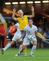 Abby Wambach (r) of team USA and Nilla Fischer of team Sweden during the FIFA Women's World Cup at the FIFA Stadium in Wolfsburg, Germany on July 6thd, 2011.